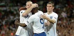 Wayne Rooney with Jermaine Defoe and James Milner